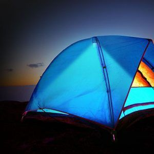 Utility lights illuminating inside of tent with no electricity