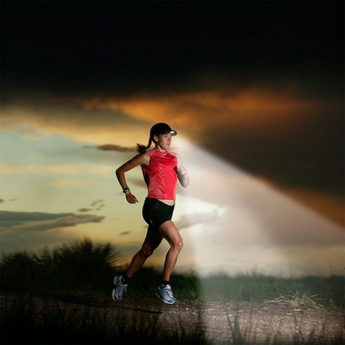 Woman running with clip on headlamp