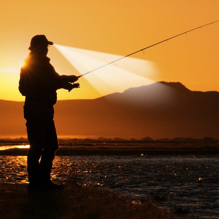 Fisherman uses light from Powercap 25/10 Structured Cotton LED hat to see into water as sun peeks above horizon