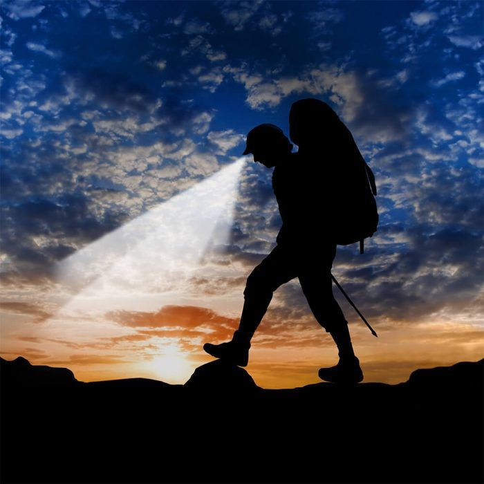 Hiker finds his way around rocky area in dimmed lighting with Powercap 25/10 Structured Cotton LED lighted hat