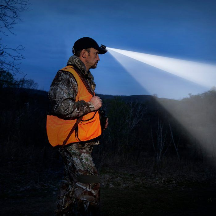 man hunting with clip on headlamp