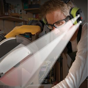 Man using LED Lighted Earmuffs at table saw machine