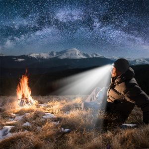 man camping with headlamp beanie