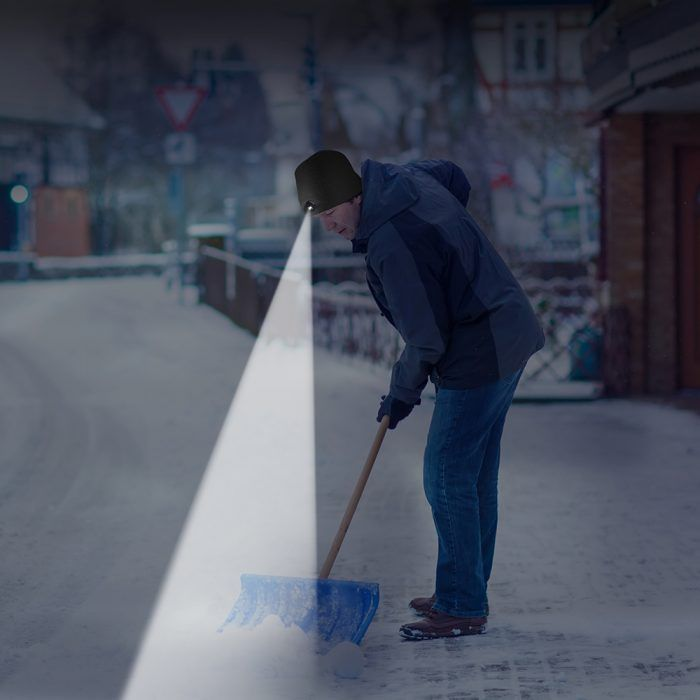 shoveling with a lighted hat