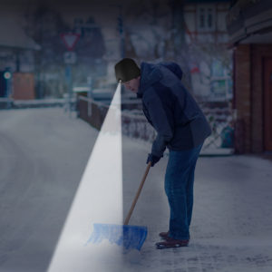 man shoveling with lighted beanie