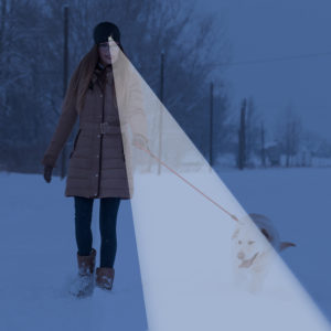 women walking dog with lighted beanie hat